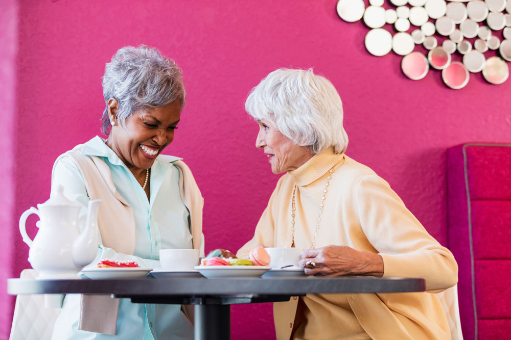 The Cottages of Fox Lake - Assisted Living and Memory Care Senior Living - Nursing home residents snacking on macaroons